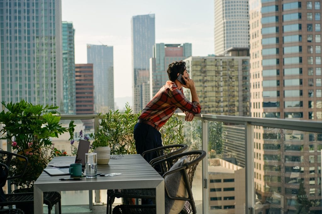 Pictured is a business traveler at a property listed on Airbnb. The company showed a net loss for the first nine months of 2019.