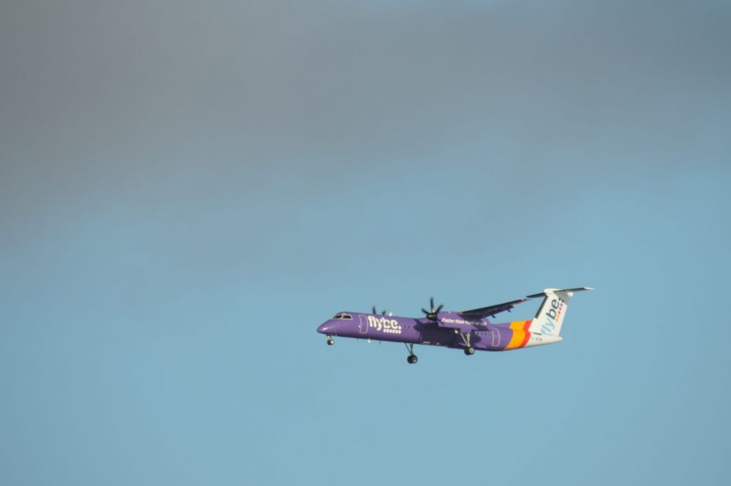 A Flybe aircraft in the sky. The airline has collapsed.