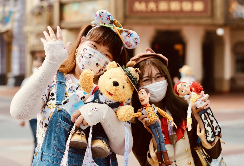 Tourists pose for a photo inside the Shanghai Disneyland theme park in east China's Shanghai, May 11, 2020. China's domestic short-haul travel is recovering.