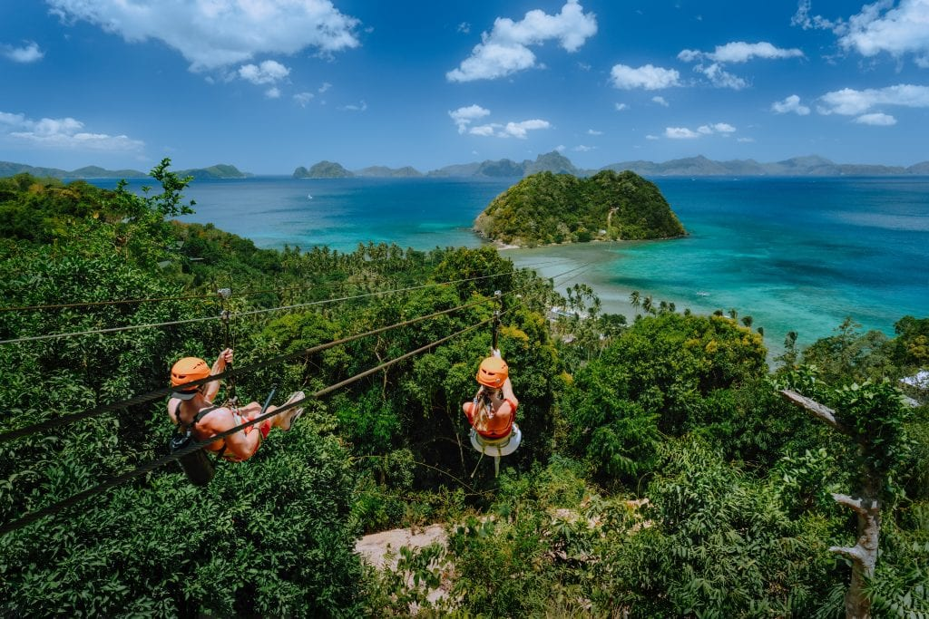 The coronavirus pandemic is forcing tour operators and attractions to heighten their health and sanitation protocols, like this zipline attraction from El Nido Resorts in Palawan in the Philippines .