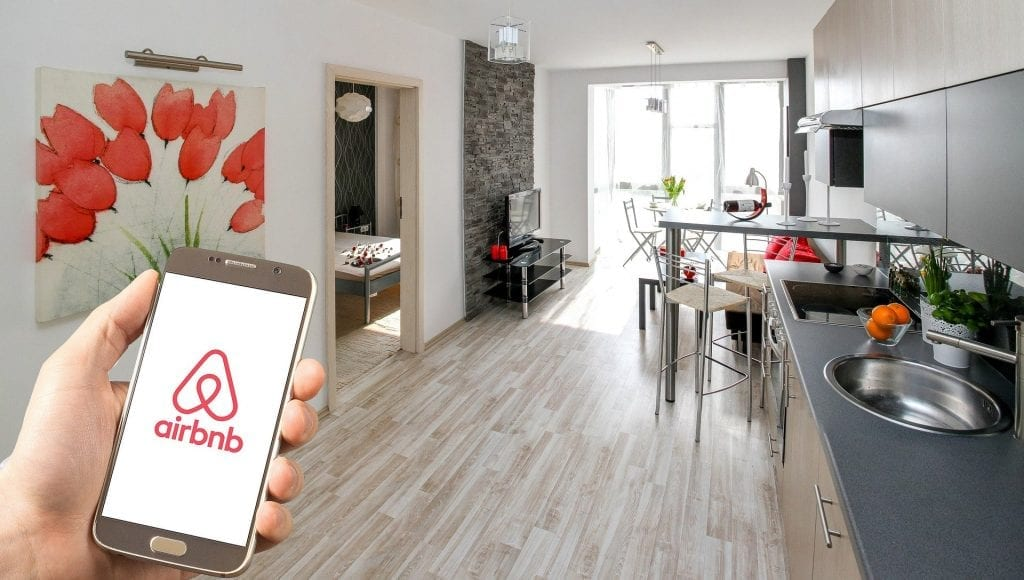 Short-term rentals are outperforming hotels in select global markets, but a travel downturn in the fall stands to hurt both hospitality sectors.