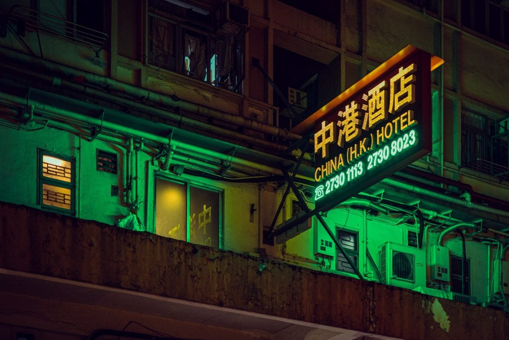 A neon sign for a hotel in Hong Kong; Trip.com is the largest online travel agency in China.