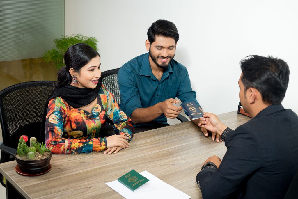 A couple pre-pandemic gets new passport documents thanks to a Bangladesh identity solution partly powered by tech firm Veridos.