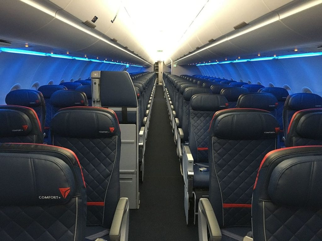 Interior of Delta Air Lines Airbus A321 shows the middle seat configuration and the limited space for social distancing on planes.