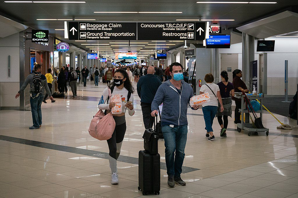 Returning travelers could find busy airports with fewer than the usual number of amenities this summer.