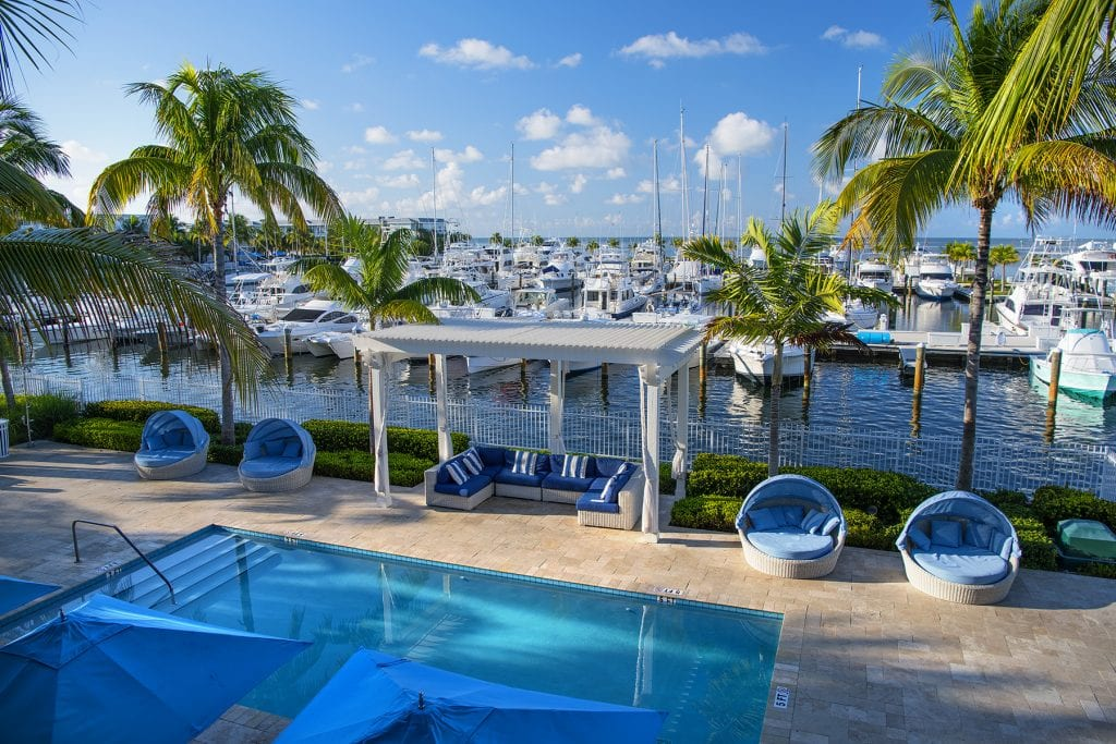 Hotels from Key West to Kennebunkport, Maine, report staffing shortages heading into the summer, largely due to stalled worker visa programs and slowed down recruiting. (pictured: Oceans Edge Resort & Marina in Key West)