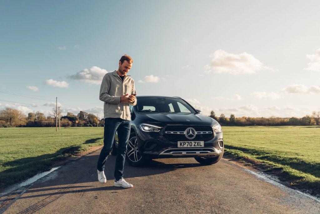 A Virtuo customer and their car rental, a Mercedes.