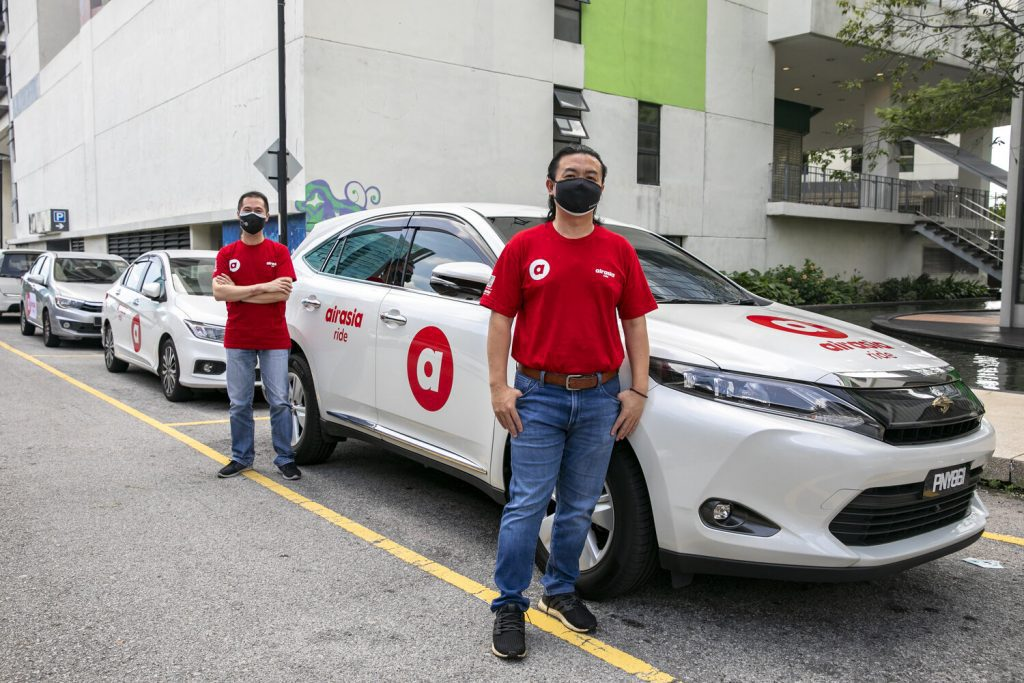 AirAsia Group chief safety officer and head of AirAsia Ride Captain Ling Liong Tien and AirAsia Ride Malaysia CEO Lim Chiew Shan posing with the newly launched AirAsia Ride vehicles now available for e-hailing.