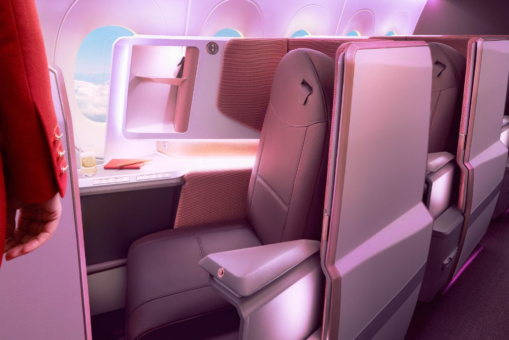 A seat on the upper deck of a Virgin Atlantic Airbus A350 in the daytime.