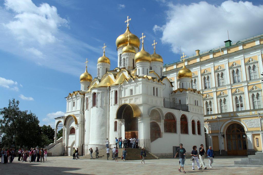 Visitors walking around the iconic Moscow Kremlin